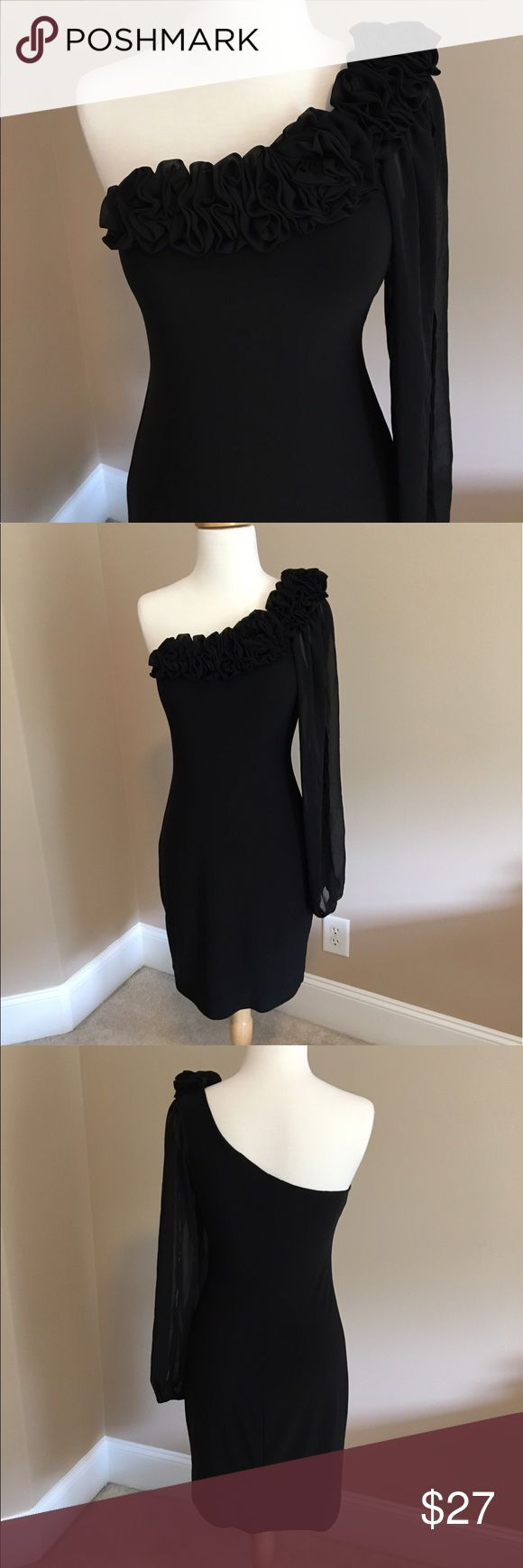 Stunning Black One Shoulder Dress B. Darlin black one-sleeve dress. The dress is mostly polyester and the sheer sleeve has a slit in it. There is gorgeous gathered detail around the neckline. The tag says size 7/8 because it's a Junior's dress but it fits like a Women's 0/2. Only worn a couple of times so it's in great condition! B. Darlin Dresses Mini