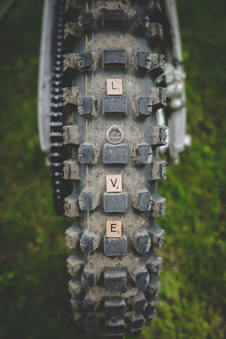 Dirt Bike engagement photo motocross style with scrabble letters and engagement ring by Vaughn Barry Photography www.vaughnbarry.com - Muskoka Wedding Photographer
