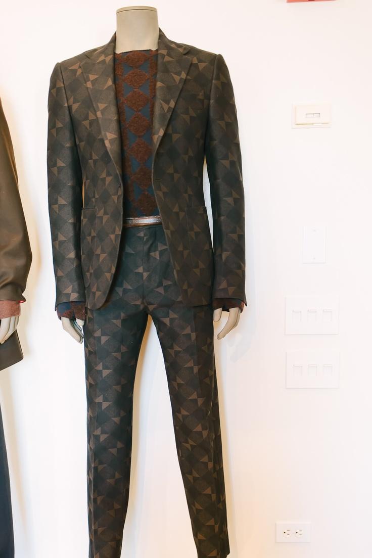 Medieval-inspired print, modern suit.