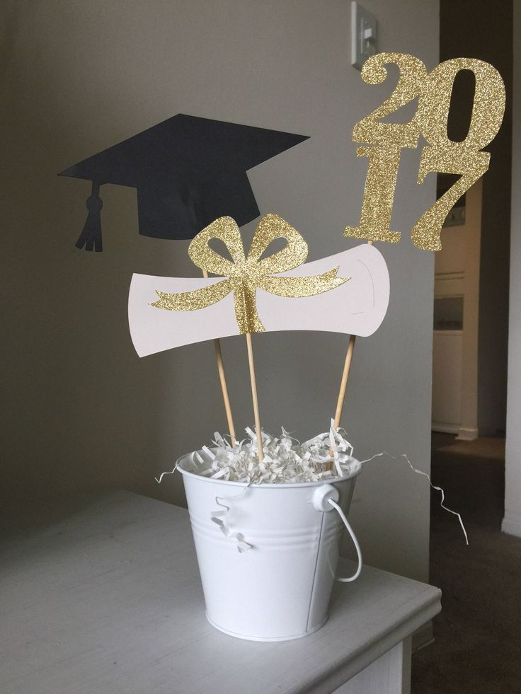 Graduation centerpiece sticks grad cap diploma