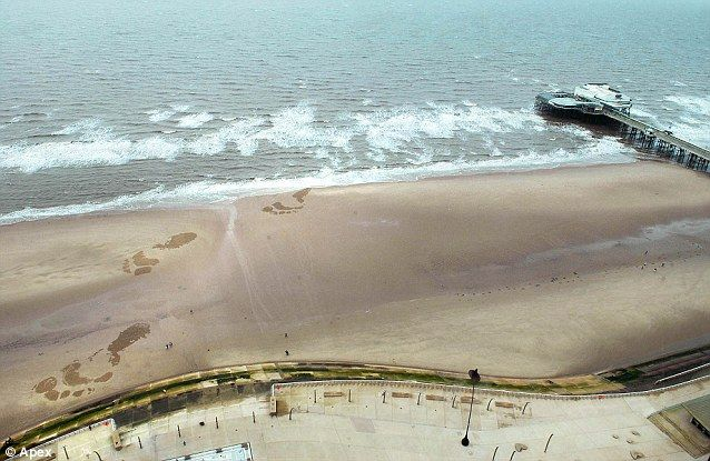 Locals were stumped when these giant footprints appeared on the beach in Blackpool.