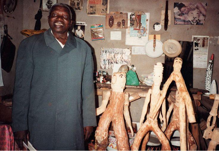 Dr. Phuthuma Seoka with some of his wood carvings.  http://www.revisions.co.za/biographies/phutuma-seoka/#.VJua0KDsCA