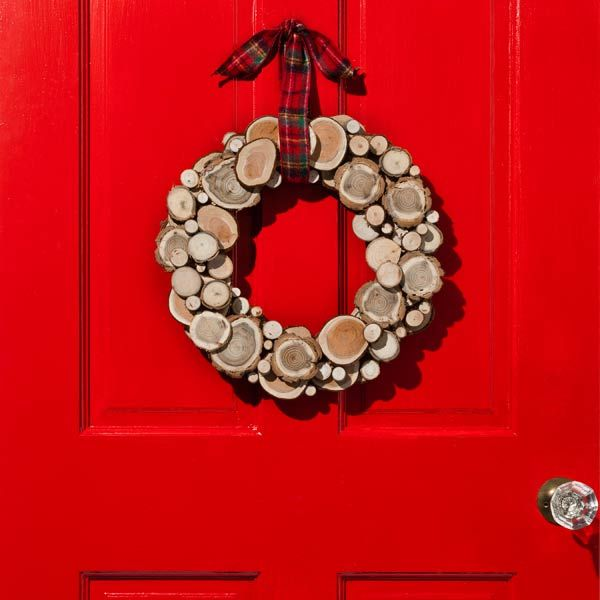 You can get more than a blast of fresh air from a trip to the backyard: You can find inspiration for a wreath. Trim small logs (1 to 4 inches in diameter) into ¾-inch-thick slices with a miter saw and mount them on a flat wreath. Wood slices are also sold in bags at craft stores and hobby shops. Plaid flannel ribbon lends a cool, rustic touch.