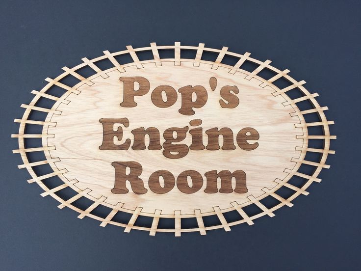 Who's Pop didn't like to play with his train set. Now everyone will know where his train room is with his door sign.