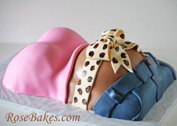 A Baby Shower Cake:  Pregnant Belly with Leopard Print Bow, Blue Jeans and a Hot Pink T-Shirt.  Click over for details and more pics!