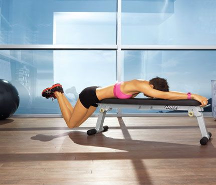 Back Attack    Lie facedown on bench with hip bones at end, legs together, toes on floor; hold bench for support, and lift lower body until parallel to floor. Keeping legs pressed together, bend knees and lower until hovering above floor (as shown). Return to start for 1 rep. Do 15 reps.
