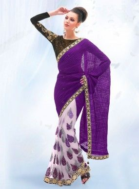 VIOLET & WHITE EVENING PROMISE SAREE - This Saree has White Net Pleats with Violet thread embroidery butta designs. The Body and Pallu is plain Violet crushed Art Raw Silk with attached stones all over. The Fancy attached border has a Shiny Brocade patch with attached stones. the blouse is beautiful with rich Brocade material and full sleeves are heavily embroided. Click photo to buy it online.#saree #netlehangasaree