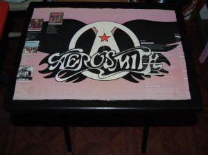 Decoupage album art onto a wooden tv tray table