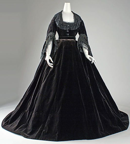 "Dress          Date: ca. 1861 (probably more like 65-66)          Culture: French       Medium: silk    Dimensions: Length at CB (a): 14 in. (35.6 cm) Length at CB (b): 26 in. (66 cm) Length at CF (c): 22 in. (55.9 cm) Length at CB (d): 26 in. (66 cm)    Marking: [label] ""Alexandrine Goujon, rue St. Honore 233""    Credit Line: Gift of M. C. Edwards, 1990 Accession Number: 1990.198a–d    Metropolitan Museum of Art"