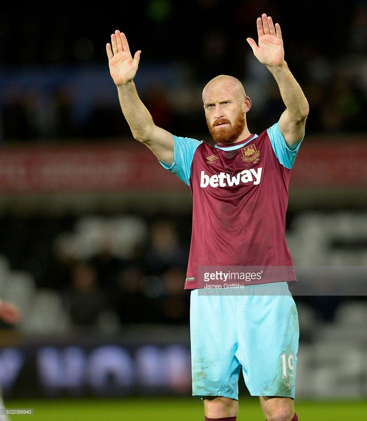 James Collins of West Ham United applauds the supporters at the final whistle during the Barclays Premier League match between Swansea City and West Ham United at Liberty Stadium on December 20, 2015 in Swansea, Wales.