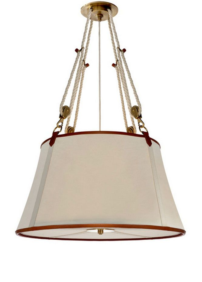 Inspired by sailboat rigging, the height of this canvas, leather-trimmed hanging shade from Ralph Lauren Home is adjustable by rope and pulley.