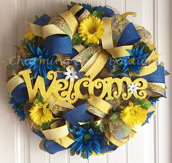 This welcome wreath would make a cute addition for both your spring decor and summer decor. Made with natural colored deco mesh and