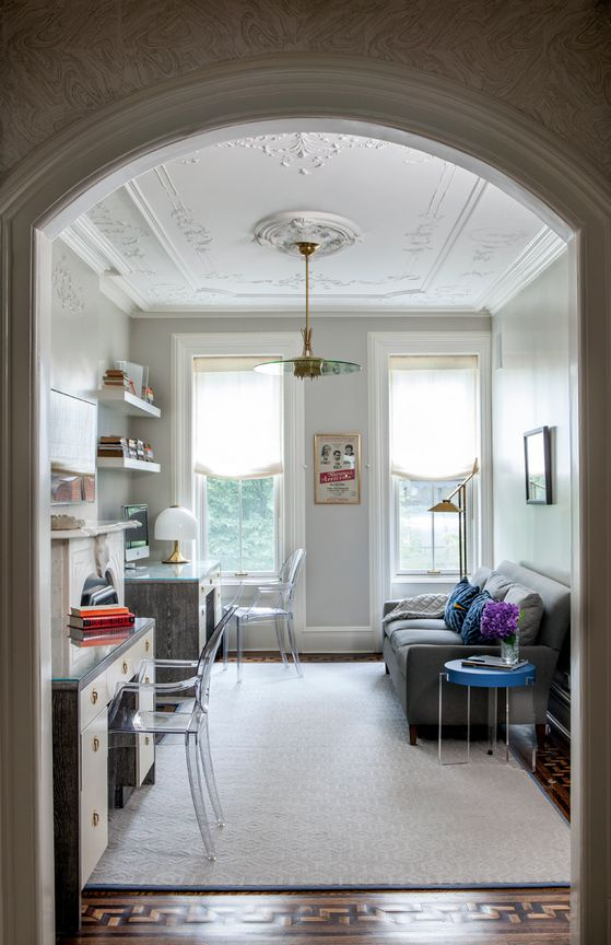 Classic Upper East Side Townhouse Gets a Funky Update // Ceiling moldings and acrylic chairs