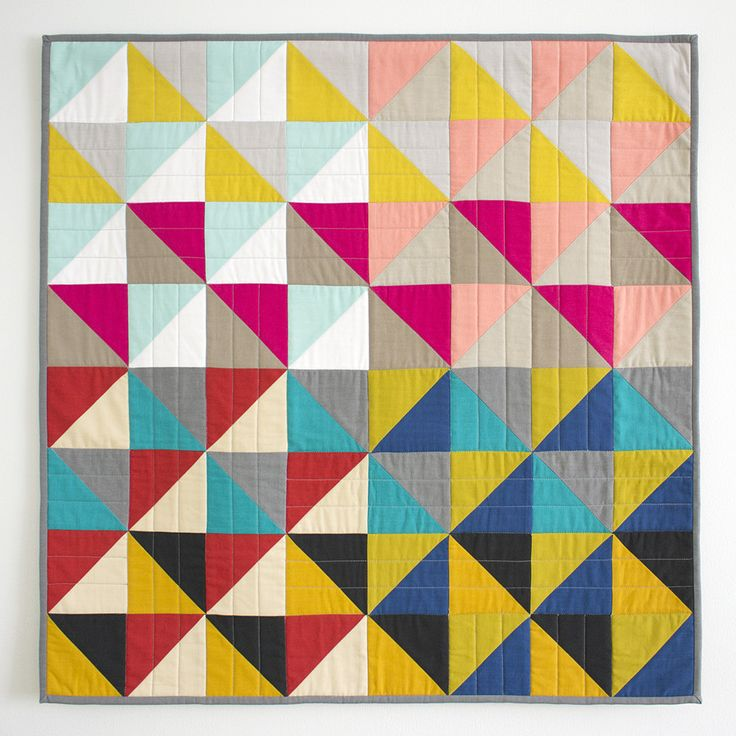Cloud9 co-owner, Michelle Engel Bencsko, got back on the quilting horse with this fairly simple project. Made entirely of 8 combos of HST strategically repeated. Quilting help from Linda Spiridon!