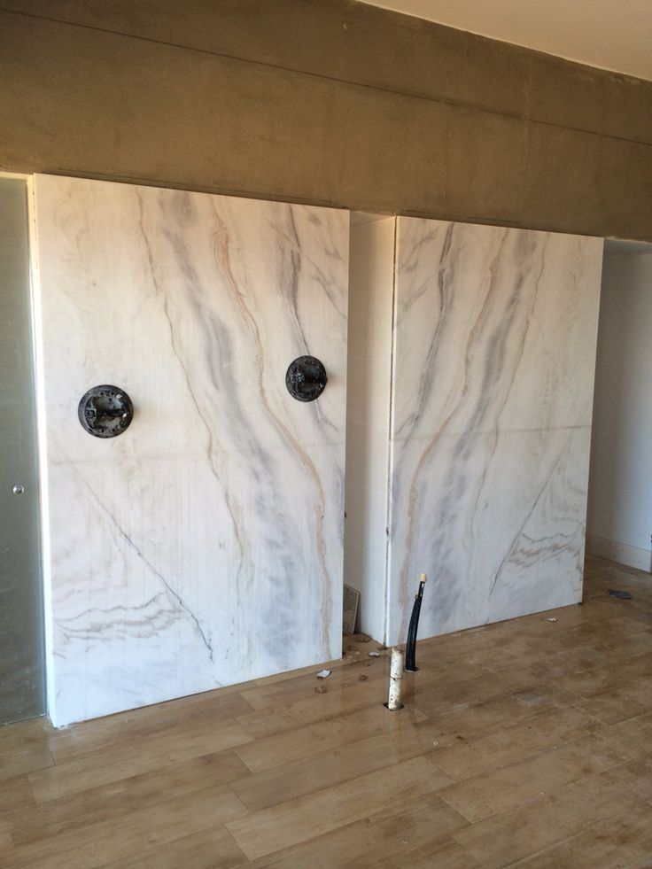 Working on marble cladding for behind a freestanding bath