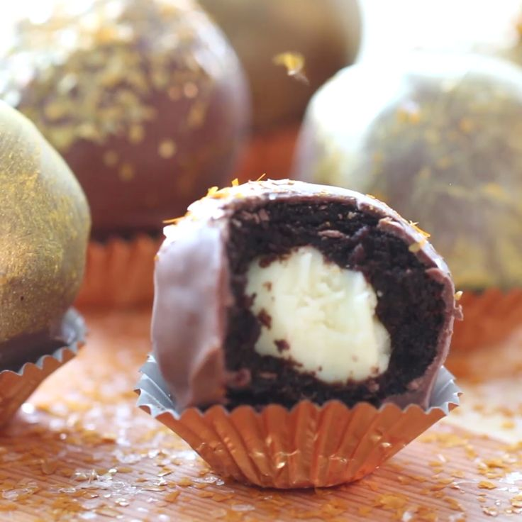 Roll into the new year with these glittery truffles! They have a surprise white chocolate ganache truffle inside!