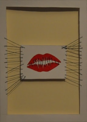 Democracy In Name Only # 2 (Mixed Media). I think this works better...the mouth has much more impact. I also decided to cut out the middle of the page and then attach the mouth to the sides of the paper using the threads to try and extend that idea. When its up against the wall you not only get the threads but you get the shadows of the thread too which makes it look like there are more holding it in place. The image is still not quite there yet but its getting better.