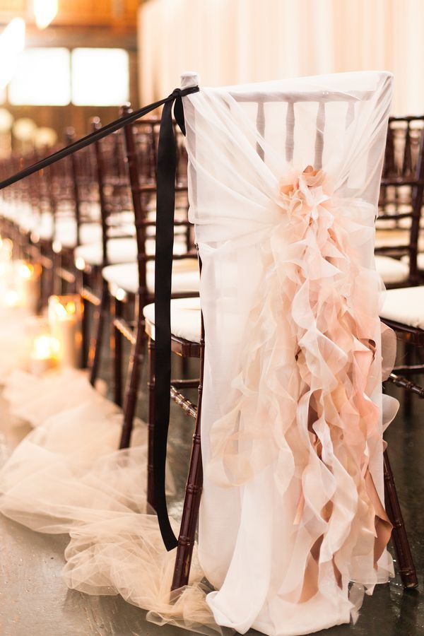 This blush ruffled chair cover is perfect for a spring or summer wedding. #ToledoWeddings #HeatherDownsCountryClub