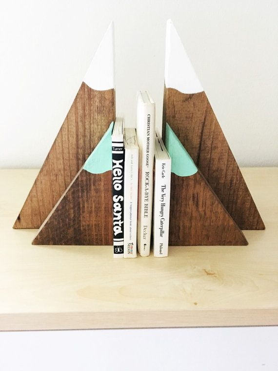 Style meets functionality in this adorable set of stained mountain inspired wooden bookends! These would make the perfect addition to any childs woodland, explorer, or whimsical bedroom, playroom or nursery! These are solid wood stained with white painted snow capped tops. *Because of the hand painted nature of this item, final product may differ slightly from the picture* This listing is for purchasing BOTH the large and small sets together. Each large half measures approximately 10.5x6.25…