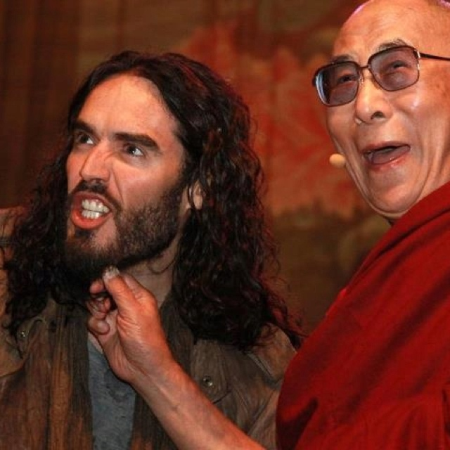 the dalai lama has said he can't resist pulling beards!  here he is goofing off with russell brand
