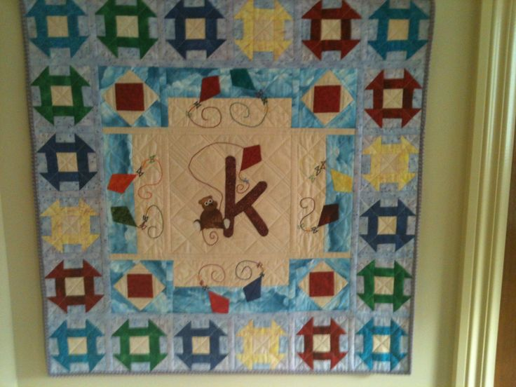QAYG, hand and machine pieced, appliqué and  embroidered.