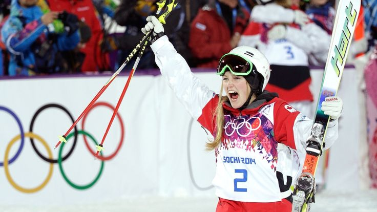 Canada's Justine Dufour-Lapointe celebrates after winning the gold medal in the women's moguls at the 2014 Winter Olympics in Krasnaya Polyana, Russia, Saturday, Feb. 8, 2014.