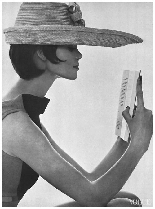 Model Marola Witt reading in hat made to block the sun. Photo by Tom Palumbo. Vogue, July 1, 1961.
