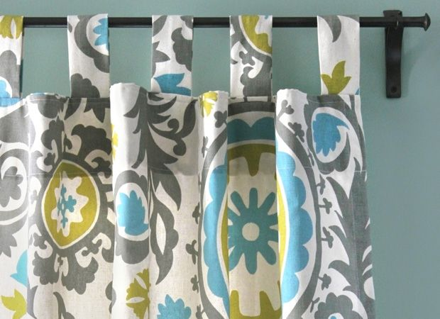 This tutorial shows you how to make tab top curtains. They slide open and closed easily, drape nicely, and tend to have a relaxed, casual feel.
