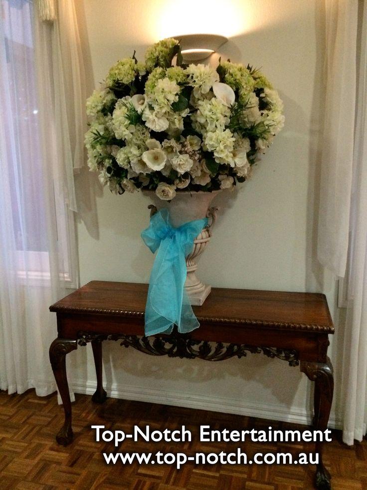 A flower arrangement at Norwood House Receptions, Mt. Eliza, Victoria.  www.top-notch.com.au  www.facebook.com/WeddingDJTopNotch