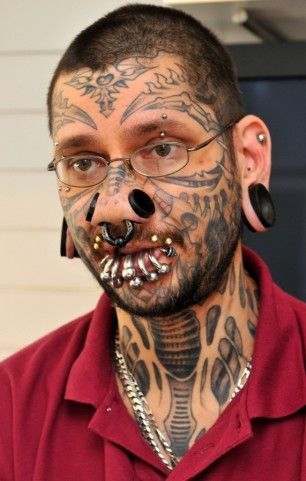 Rouslan Toumaniantz, a Belgian tattooist is being sued for tattooing 18 year old Kimberley Vlaminck's face with 56 tiny stars, claiming she only asked for 3...    Now lets face it, if you go into a tattoo parlour and the guy looks like this. Alarm bells should be ringing surely...?