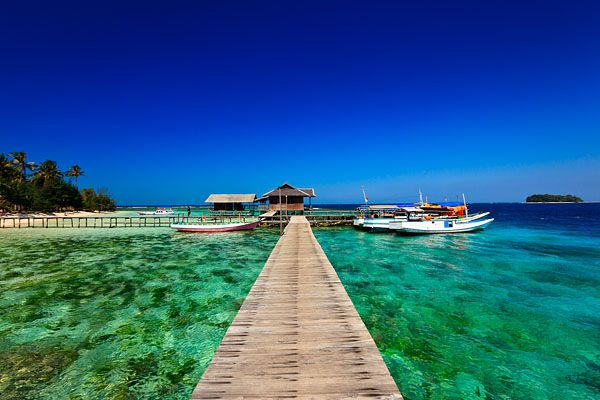 Crystal clear waters and colourful coral reefs around the small island of Pulau Tengah, located within the Marine National Park of Karimunjawa or Karimun Jawa, which translates as a stone's throw from Java.