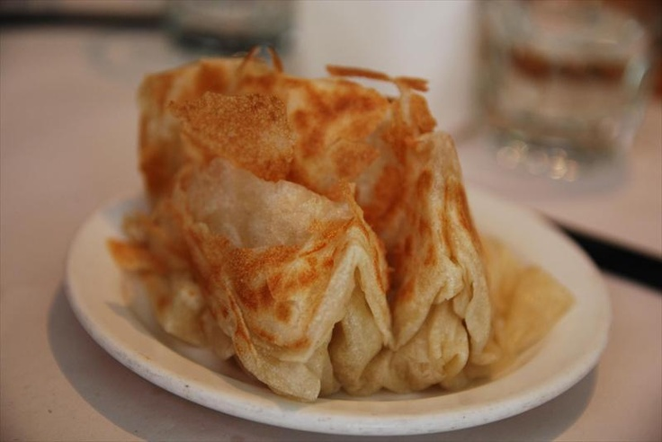 Little Malaysia.  City.  Liverpool Street.  Cheap and cheerful.  Menu can be hit and miss, but this place could survive on its perfect roti chanai alone.