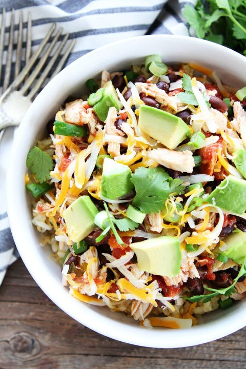 Slow Cooker Mexican Chicken Recipe on twopeasandtheirpod.com This easy crockpot chicken dinner is a family favorite!
