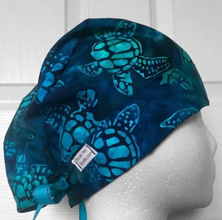 Navy blue batik sea turtles cotton tie back hat with adjustable front folding band, elastic backing, and ribbon ties. **also available in the new Pixi style**