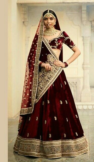 Latest and trending bridal dupatta draping styles | Double dupatta draping ideas | maroon red lehenga with zardosi details | Sabyasachi Mukherjee | Velvet dupatta with golden zari embroidery | Every Indian bride's Fav. Wedding E-magazine to read. Here for any marriage advice you need | www.wittyvows.com shares things no one tells brides, covers real weddings, ideas, inspirations, design trends and the right vendors, candid photographers etc.