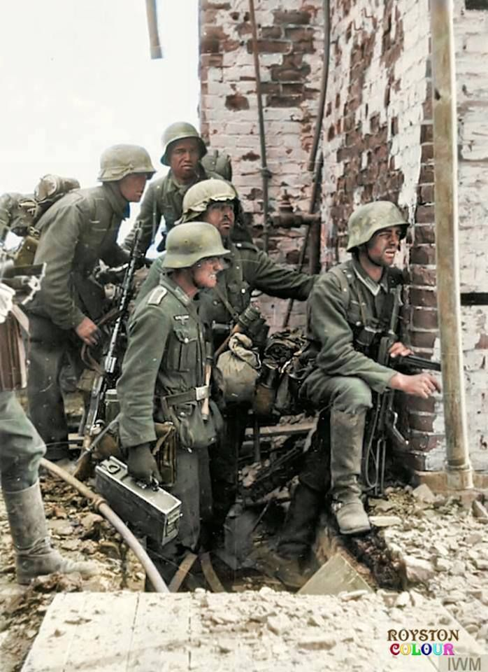 German 6th Army Infantrymen pause in the ruins during heavy fighting with Soviet forces during the Battle of Stalingrad, (in present day Volgograd Oblast), Russia. September/October 1942.