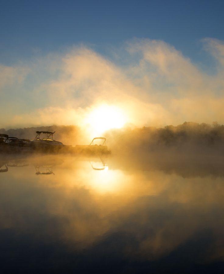 A marina floating in sunrise fog on Lake Norman.
