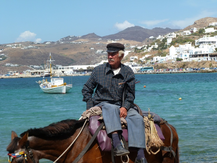 My favorite photo in Mykonos!  A Greek fisherman.  He stopped and had something to drink and was on his way!  Love it!!!!!