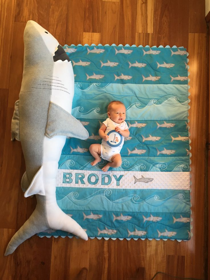 Brody at one month with shark baby quilt and shark .