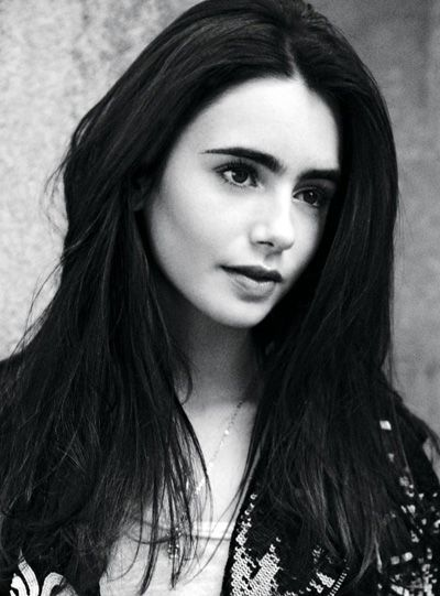 Lily Collins. From Abduction. She better NOT take irem boy, Taylor Lautner!!!!