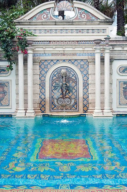 Blue mosaic tiles in the pool of the art deco versace for Versace pool design