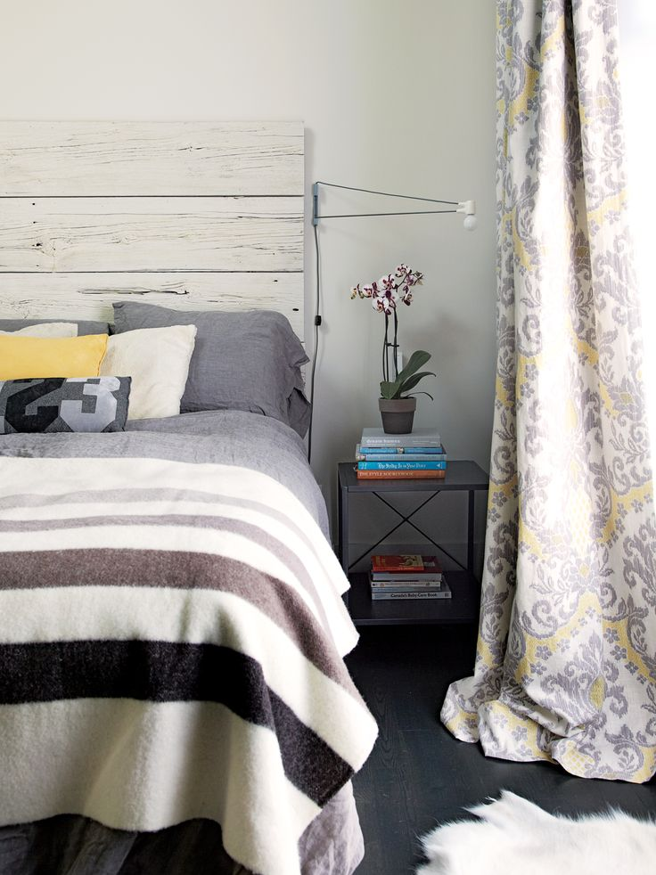 painted wood headboard + swing arm sconces + neutral bedroom palette