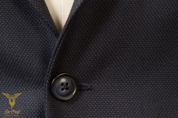 Detail of a blue birdseye durable hardwearing suit witch notched lapels. Bespoke tailored with 100 percent worsted suiting fabric from the InterCity collection by Holland & Sherry. 370 gram, 12 oz.  #bespoke #tailoring - www.deoost.nl