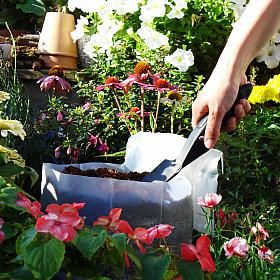 Gardening - SmartGarden Potgrond Compost - With SmartGarden Potgrond Compact Compost you will no longer need to tote heavy bags of potting soil! Potgrond Compact is pre-fertilized compressed potting soil based on coir pith in handy, re-sealable, compact block bags.