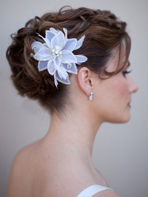 I want this hairstyle with the flower, and a draping veil from the back.