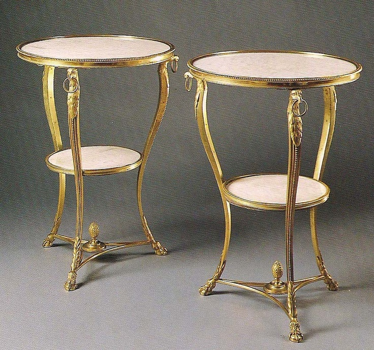 A pair of Empire style ormolu and marble gueridons.