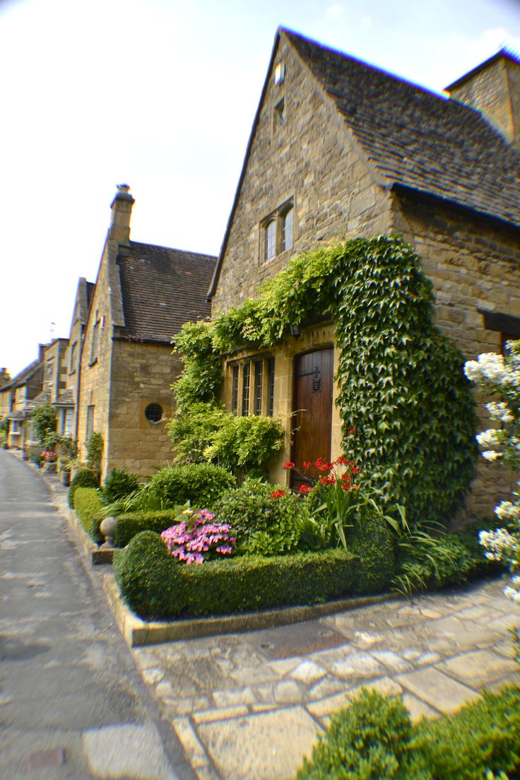 The ivy growing over the door and all that lovely greenery.  Cotswolds - England.
