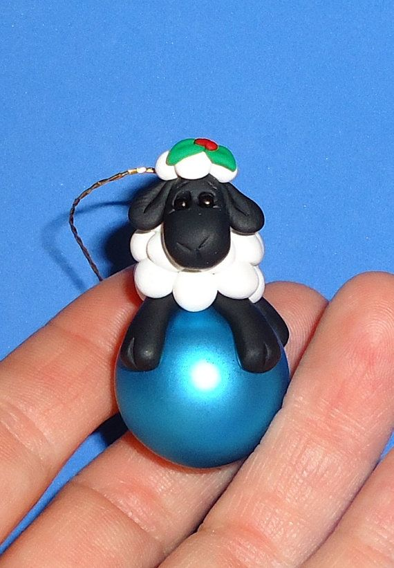 Various colors of glass balls are available. This little lamb on a glass ball measures just under 2 tall.