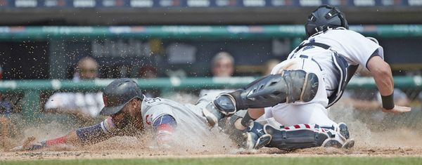 Cleveland Indians Carlos Santana (41) dives in safe at home ahead of the tag by Detroit Tigers catcher James McCann (34) during the third inning in game one of a doubleheader in Detroit, Saturday, July 1, 2017. (AP Photo/Rick Osentoski) Indians and Tigers split DH with Tigers taking the first and Tribe winning the second.