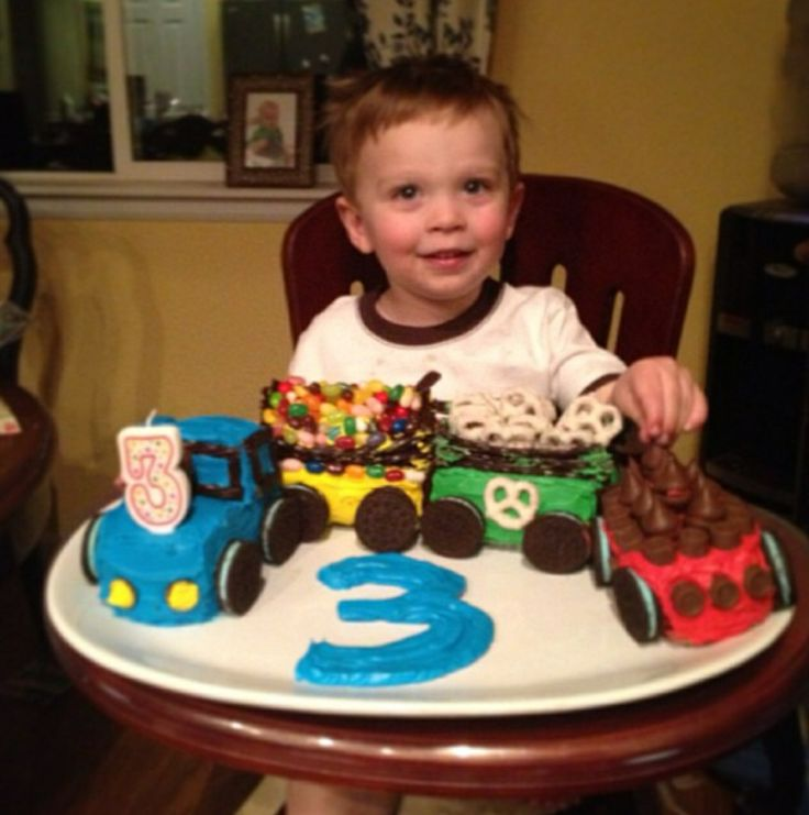 "Mikey's train cakes from his 3 rd birthday last year. He's still mad about Thomas and I'm hoping to step it up for his 4 th birthday cake. Wheels were made of Oreos and the ""tender"" were filled with jelly beans, chocolate covered pretzels and kisses."